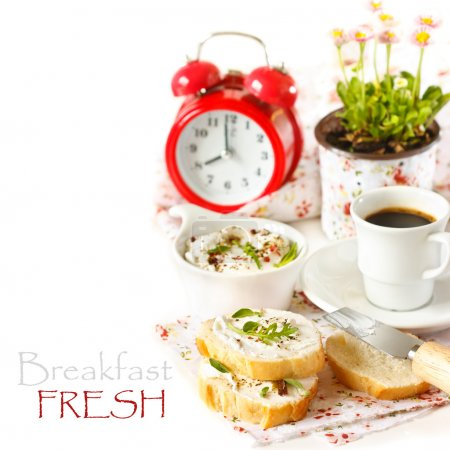 Photo for Fresh cream cheese spread with spices and herbs on a crispy baquette and cup of coffee for breakfast. - Royalty Free Image