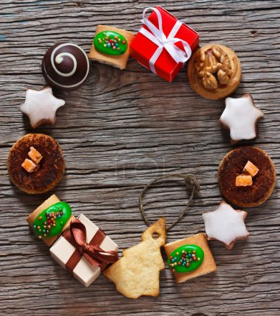 Photo for Christmas wreath of cookies on a wooden background. - Royalty Free Image