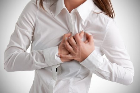 Woman having a pain in the heart area...
