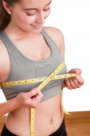 Woman Measuring Up Her Chest