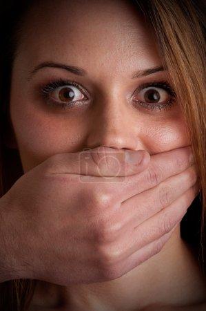 Woman Silenced by Aggressive Husband