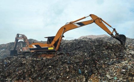 Excavator working in a landfill