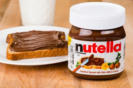 Jar of Nutella with toast and milk