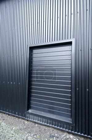 The black metal door