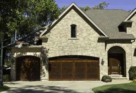 Typical american house with two door car garage