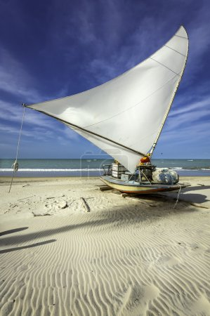 Traditional small fishing boat on the beach of Fortaleza, Brazil