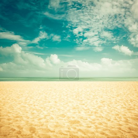 Photo for Sunshine on empty beach - vintage look - Royalty Free Image