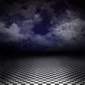 Empty, dark, psychedelic artistic image with black and white checker floor on the ground and ray of light in cloudy, dark denim blue sky. Gothic, drama background for poster or wonderland image.