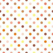 Seamless vector pattern background or texture with colorful yellow orange pink brown and beige polka dots on white background