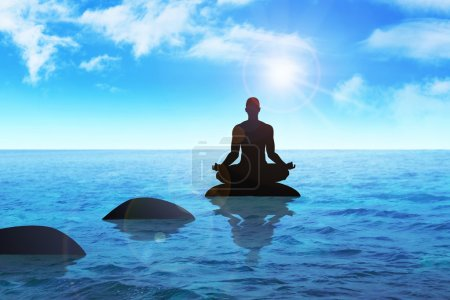 Photo for Silhouette of a man figure meditating on a stone - Royalty Free Image