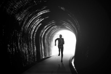 Photo for Silhouette illustration of a man figure running in the tunnel - Royalty Free Image