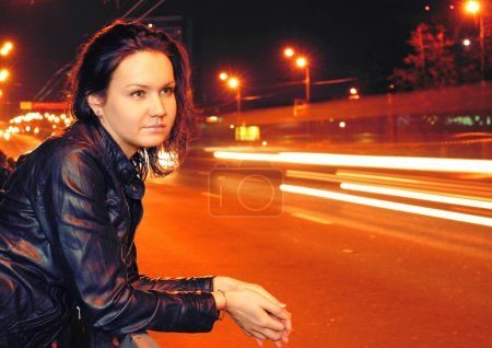 Photo for Beautiful young woman in night city - Royalty Free Image