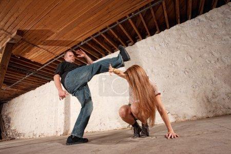 Man Kicks Young Woman