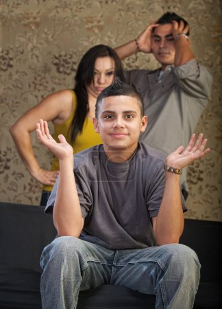 Grinning Young Man with Angry Parents