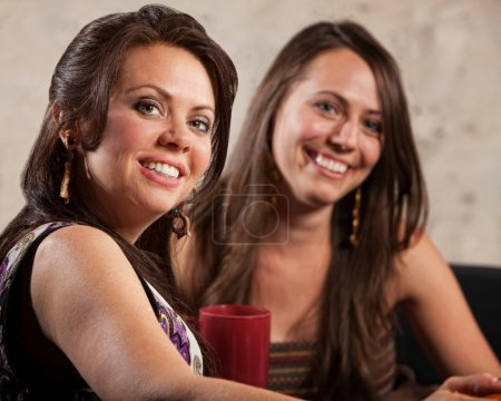 Two Beautiful Women Sitting Together