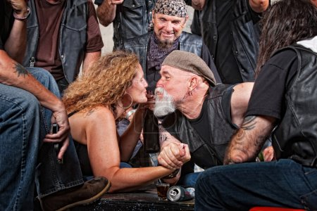 Lovers Kiss While Arm Wrestling