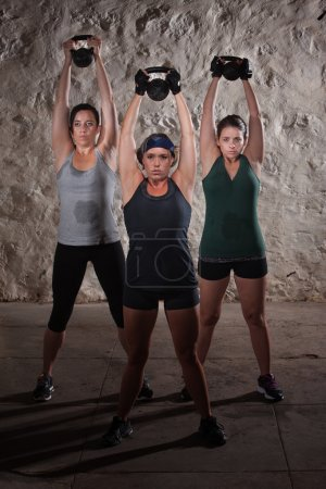 Sweating Women Doing Boot Camp Exercises