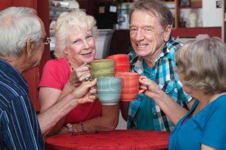 Senior Adults Toasting with Mugs