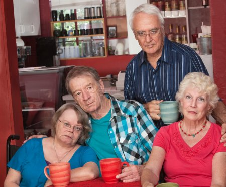 Photo for Sad group of four senior citizens in cafe - Royalty Free Image