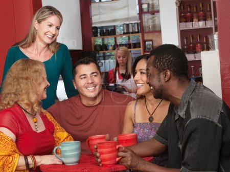 Photo for Smiling diverse group of mature adults in cafe - Royalty Free Image