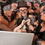 Annoyed motorcycle gang sticks up nerd using lapto...