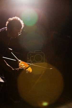 Artist Trimming Glass