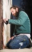 Kneeling Man Spray Painting