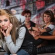 Pouting teen with chin in hands in alley...