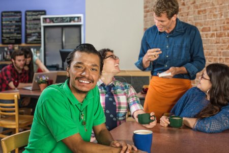 Smiling Man with Friends and Barista