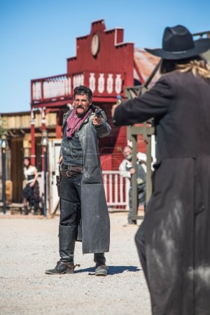 A Sheriff Duels Bandit in the Middle of Town...