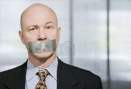 Muzzled Businessman