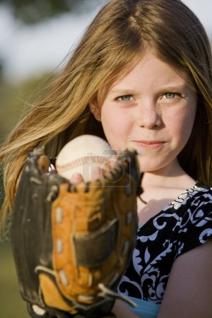 Photo for Cute young girl in summer dress with a baseball - Royalty Free Image