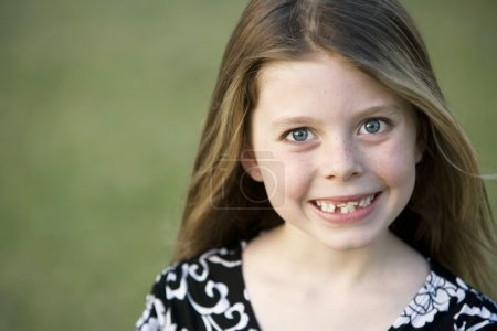 Pretty Young Girl with Freckles and a Big Smile an...