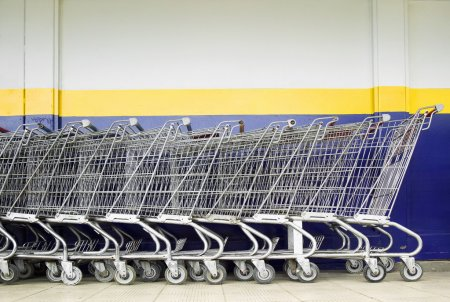 Photo for Line of old style shopping carts outside a supermarket - Royalty Free Image