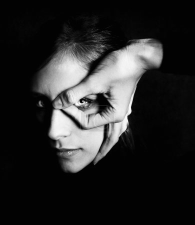 Model with dark makeup circling her eye