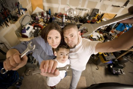 Do-It-Yourself family with wrenches