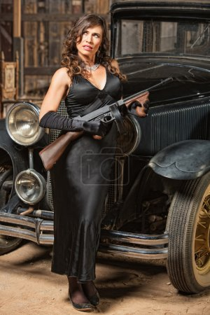 Lady with Gun Looking Away