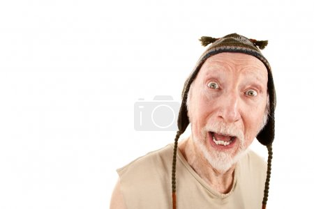 Senior man with surprised expression wearing knit ...