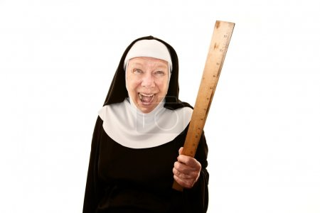 Crazy laughing nun on white brandishing a ruler...