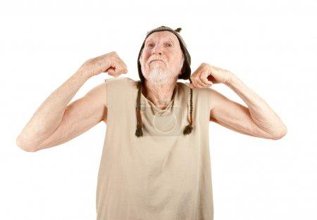 Crazy senior man flexing muscles