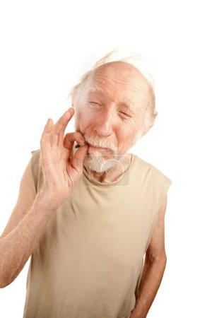 Senior man smoking cigarette or marijuana