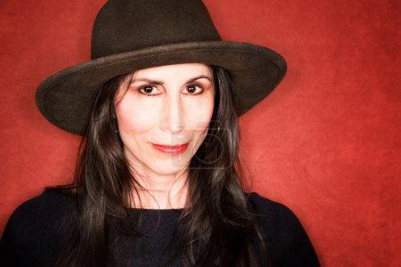 Pretty woman in a dark hat