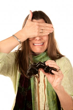 Woman covering her eyes after using binoculars