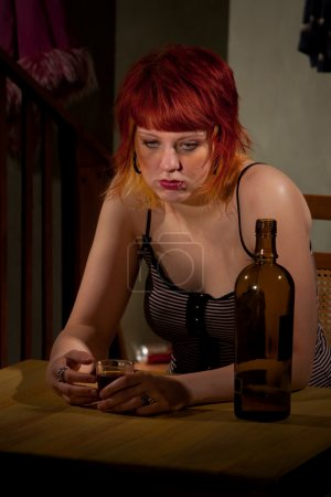 Photo for Underage alcoholic woman with bottle of wine - Royalty Free Image