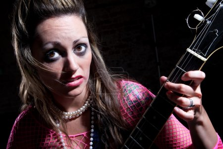 Photo for Young punk rocker girl with electric guitar - Royalty Free Image