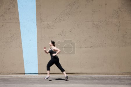 Single woman runs to get in shape