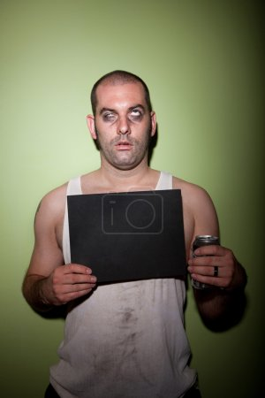 Man with drink in mugshot