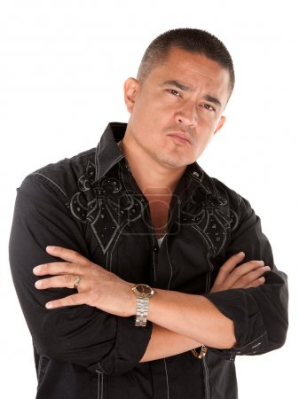 Photo for Native American looking tough with folded arms on white background - Royalty Free Image