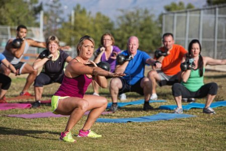 Mixed Group Doing Boot Camp Exercise