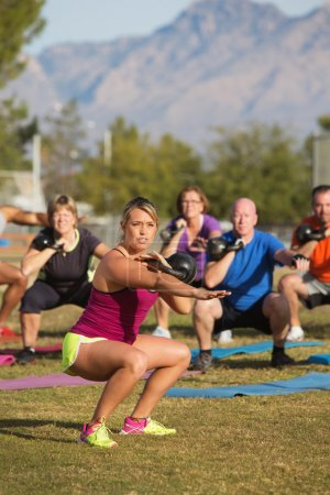 Photo for Mixed group of adults training with weights outdoors - Royalty Free Image